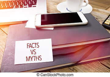 Card saying Myths and Facts on note pad
