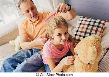 Grandfather taking care about his grandchild - Attentive...