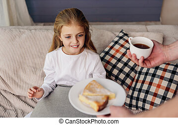 Man treating his daughter by breakfast - Help yourself with...