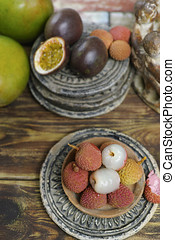 Lychees and Passion Fruit or Maracuya and Mango on wooden...