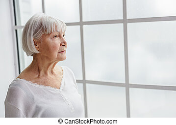 Thoughtful retiree looking what going on - Waist up portrait...