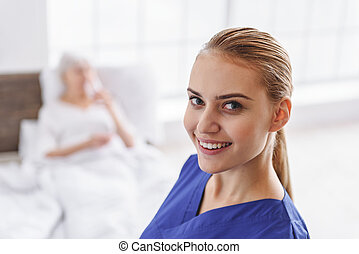 Outgoing physician situating in apartment of patient - Focus...