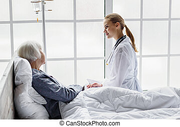 Outgoing physician monitoring physical condition of retiree...