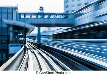 Moving train into tunnel, blurred motion
