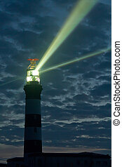 powerful lighthouse - creach lighthouse at night on ouessant...