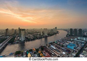Beautiful sunset sky over Bangkok river curved