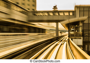 Blurred motion of moving train into tunnel