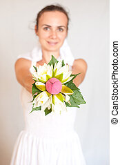 Bride shows her wedding bouquet - Beautiful young bride...