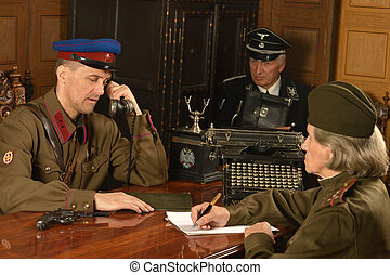 Military mature general at  the table with soldiers