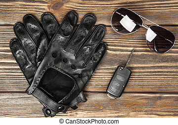 Car keys and driving gloves - Car keys and a pair of leather...