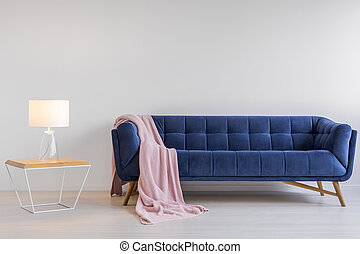 Room with upholstered sofa - White room with blue...