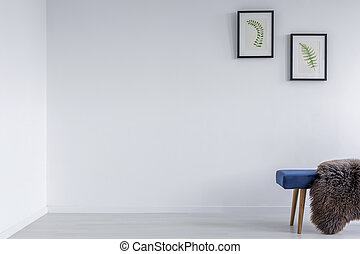 White room with blue bench