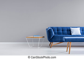 Grey room with blue couch