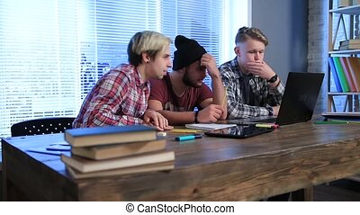 Students checking exam results on laptop computer - Group of...