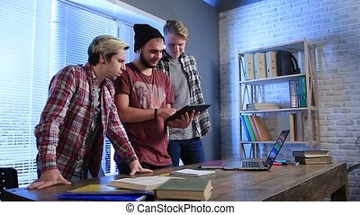 Group of teenagers in classroom with a tablet pc - Group of...