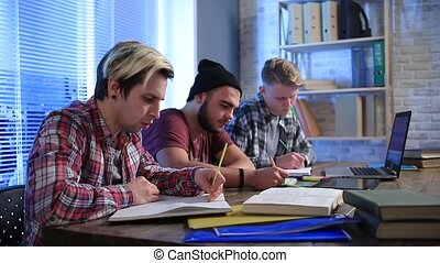 Several classmates taking lecure notes to notebook - Group...