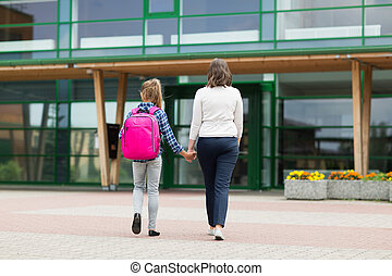 student girl with mother going to school