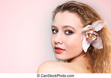studio shot of beautiful young woman