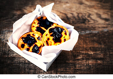 Pasteis de Nata - creamy egg tart with sweet curstard, black...