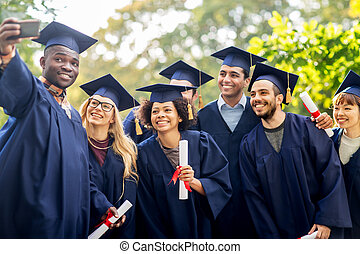 students or bachelors taking selfie by smartphone -...