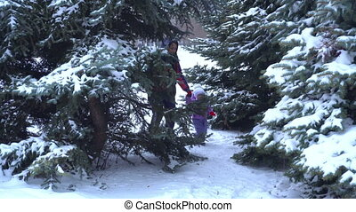 mom with baby steps between a snowy trees