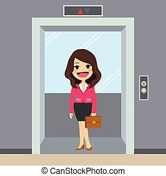 Elevator Businesswoman - Young happy businesswoman using...