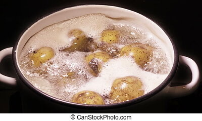 Potatoes boiling in a pan