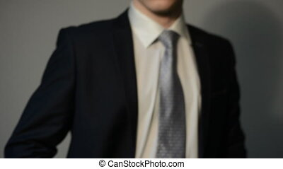 Close-up portrait of a serious young businessman