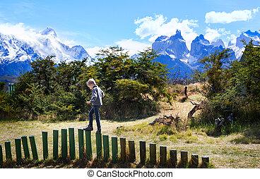 kid in patagonia - little boy having fun in torres del paine...