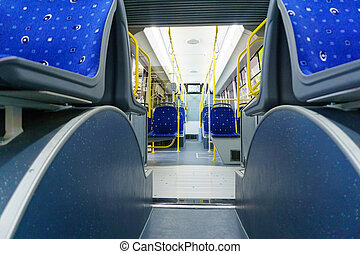 New modern cabin of city transport with modern blue seats