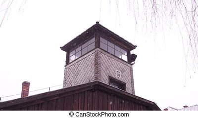 Steadicam shot of concentration camp watch tower in falling...