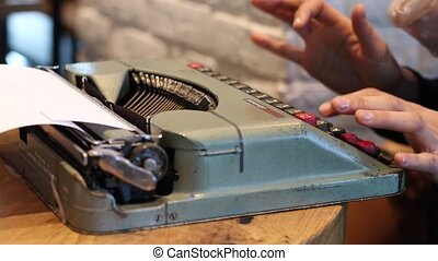 Writer with old fashion typewriter - Woman using typing...