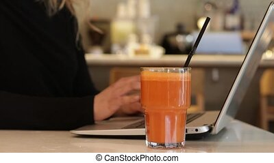 Woman drinking fresh carrot juice