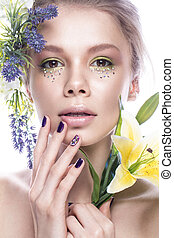 Beautiful girl with art make-up, flowers, and design nails manicure. beauty face.
