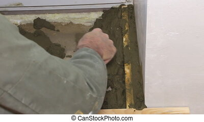 Plasterer working with cement and trowel