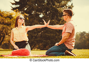 Cheerful couple having fun in park. - Love romance...