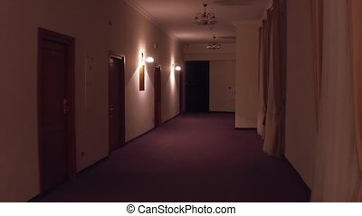 POV steadicam walk through generic hotel corridor. Automatic...