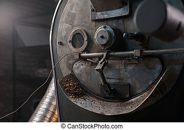 Coffee beans cooking during the roasting process, drum type...