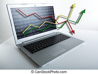 working at a laptop analytics forecasting calculations -...