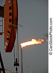 Oil Field  flame burn off gas oil jack well pump