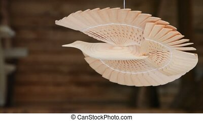 Russian bird of happiness, made of wood hangs by thread...