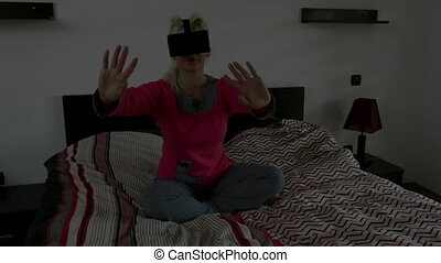 Pretty young woman playing game using virtual glasses in...