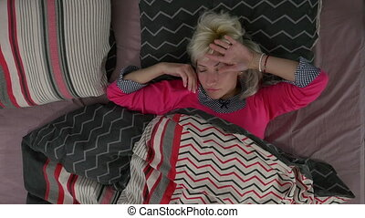 Pretty young woman sleeping peacefully and moving in her...