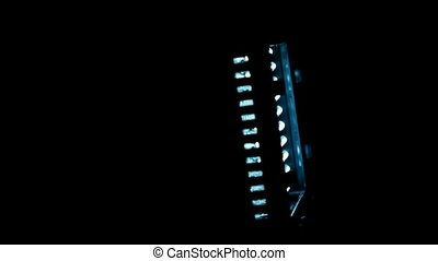 Searchlight, which consists of bright blue Light-emitting diodes, rotates clockwise in dark