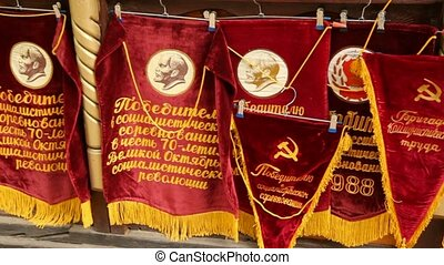 souvenir flags and pennants with Soviet symbols are on...
