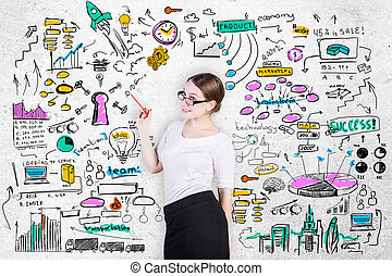Entrepreneurship concept - Cheerful young businesswoman on...