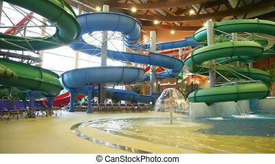 Large indoor water park with pools, fountains, slides