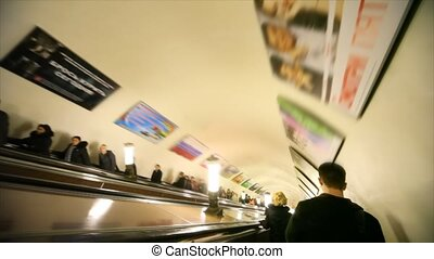 People down in subway on escalator, Komsomolskaya station,...