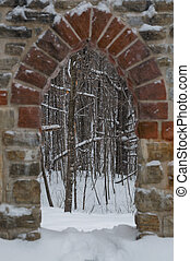 Gothic stone door way with Maple trees in winter - Gothic...