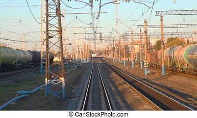 camera moving on rails past electric power lines